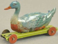 Meier Tin-Penny Toy Duck on platform with red disc...