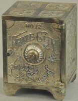 Nicol & Co. Cast-Iron-Mechanical Banks Large white city...