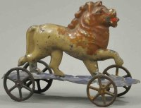 Fallows Tin-Animals Small lion on platform, early...