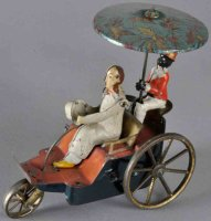 Unknown Tin-Penny Toy Man with pipe pushing wheelbarrow,...