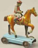 Unknown Tin-Penny Toy Jockey on horse, lithographed tin,...
