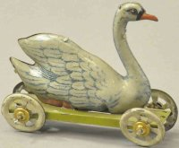Meier Tin-Penny Toy Swan on light green platform,...