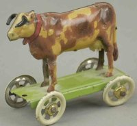 Unknown Tin-Penny Toy Bull on light green platform,...