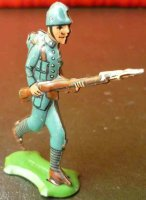 Fischer Georg Tin-Penny Toy Soldier on green platform,...