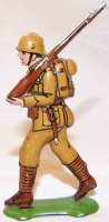 Fischer Georg Tin-Penny Toy Soldier in the typical khaki...