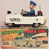 Nomura Toys Tin-Cars Battery operated police car, made of...