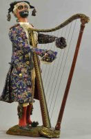 Vichy Tin-Automata Monkey harpist, a monkey-person with...