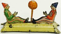 Meier Tin-Penny Toy Tin lithographed two clowns playing...