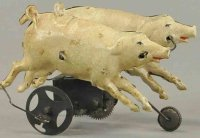 Unknown Tin-Figures Two walking pigs, hand painted tin,...