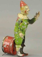 Guenthermann Tin-Clowns Tin musical clown with painted...