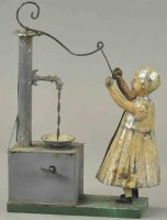 Unknown Tin-Figures Tin girl at water pump, very charming...