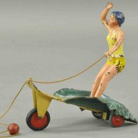 Hubley Cast-Iron Figures Surfer girl pull toy made of...