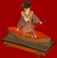 Verlingue Jules Wood-Toys Pull toy, figur in boat on a...