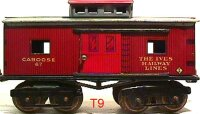 Ives Railway-Freight Wagons Caboose #67 (1920) with eight...