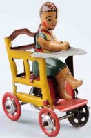 Distler Tin-Penny Toy Child in chair with four spoke...