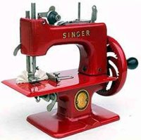 Singer Toy sewing machines Toy sewing maching #2010 red....