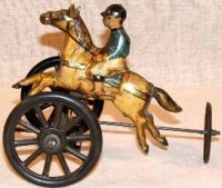 Carette Tin-Figures Rider on horse with three wheels,...