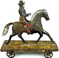 Hull & Stafford Tin-Figures Horse with rider on platform...