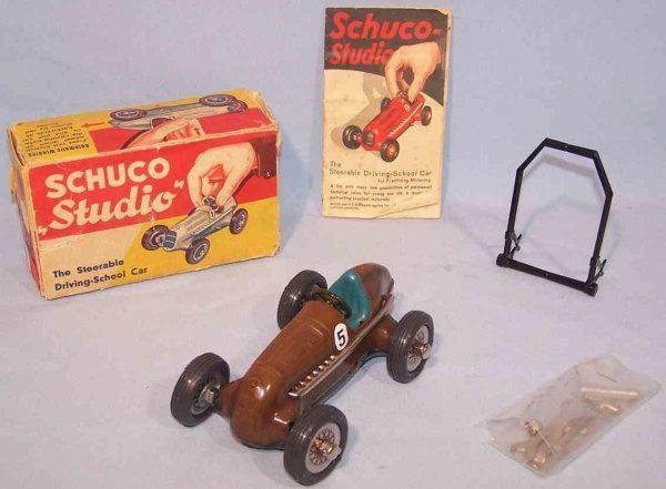 Schuco Tin-Race-Cars Race Car Studio #1050/5 in brown, from sheet metal with rubb