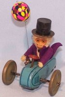 Schuco Tin-Figures Clockwork scooter #858 with a monkey...