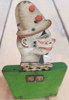 Unknown Tin-Clowns Mechanical smiling clown made of...