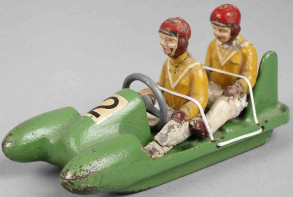 Heusser Karl Cast-Iron-Toys Hela-Bob, two-man bob with two plastic, removable figures, m