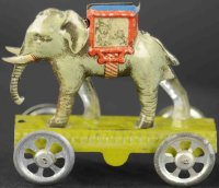 Meier Tin-Penny Toy Elephant on light green embossed...