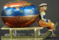 Unknown Tin-Penny Toy Girl on sleigh with egg. Whimsical...