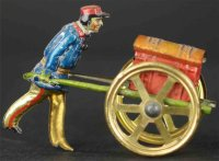 Meier Tin-Penny Toy Soldier pushing red trunk with gold...