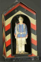 Unknown Tin-Penny Toy Soldier in doorway as bank. This...