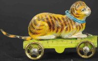 Fischer Georg Tin-Penny Toy Cat sitting on light green...