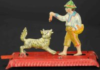 Meier Tin-Penny Toy Man feeding dog of lithographed tin,...