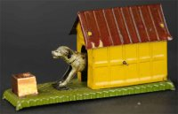 HMN Tin-Penny Toy Mechanical dog in yellow kennel wit...