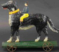 Fallows Tin-Figures Large dog with rider, wheeled...