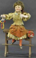Vichy Tin-Automata Girl on school desk. Smiling child...