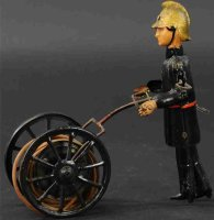 GAMA Tin-Figures Fireman with hose reel, wind-up toy,...