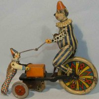 Kellermann Tin-Clowns Clown with bicycle with a little...
