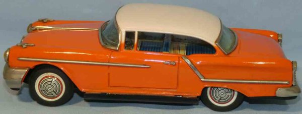 Ichiko Tin-Cars Oldsmobile with flywheel drive. Made of sheet metal, hand pa