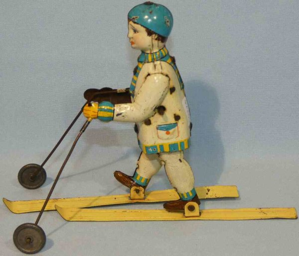Hammerer & Kühlwein Tin-Figures Skier with clockwork. Made of sheet metal, lithographed in w