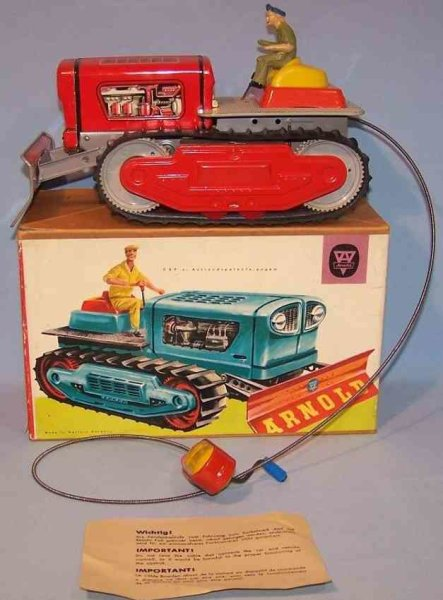 Arnold Tin-Tugs/Rollers Bulldozer with spiral crank #7900 in original box. Made of s