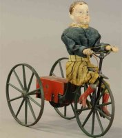 Stevens & Brown Tin-Figures Boy on velocipede. Boy with...