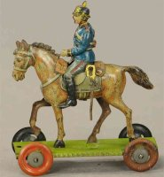 Meier Tin-Penny Toy Soldier on horse. Soldier in blue...