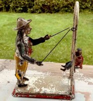Guenthermann Tin-Figures Swinging monkey and trainer on...