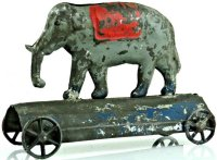 Brown George Tin-Figures Elephant on blue platform with...