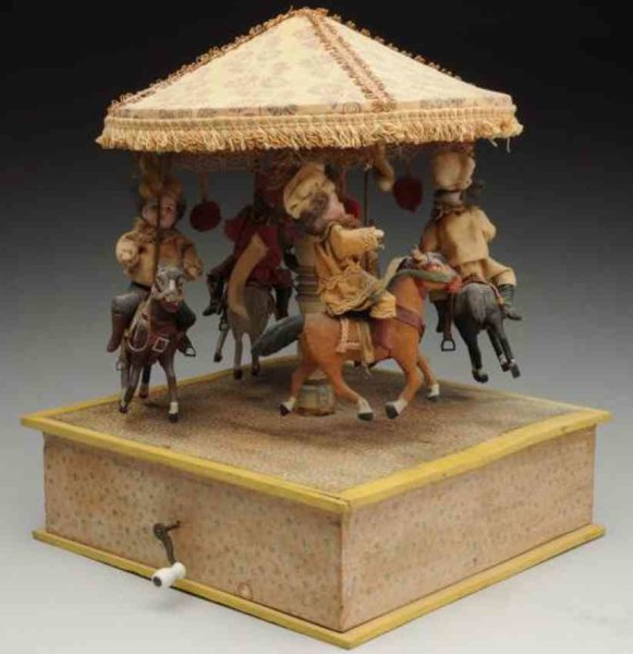Unknown Tin-Automata Musical mechanical carousel toy. Four bisque-headed children