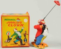 TPS Tin-Clowns Juggling clown with wind-up, made of...