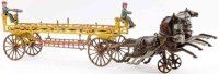 Ives Cast-Iron-Carriages Cast iron ladder wagon...