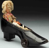 Ives Cast-Iron-Toys Old woman in the shoe, made of cast...