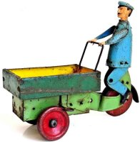 Guenthermann Tin-Figures Rare porter with three-wheeled...