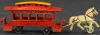 Wilkins Cast-Iron-Trams Trolley, a red trolley car topped...